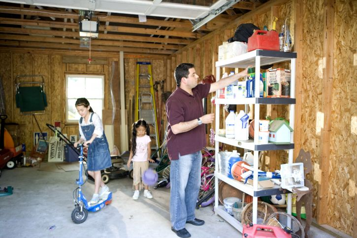 children-playing-in-garage-while-father-working-725x483
